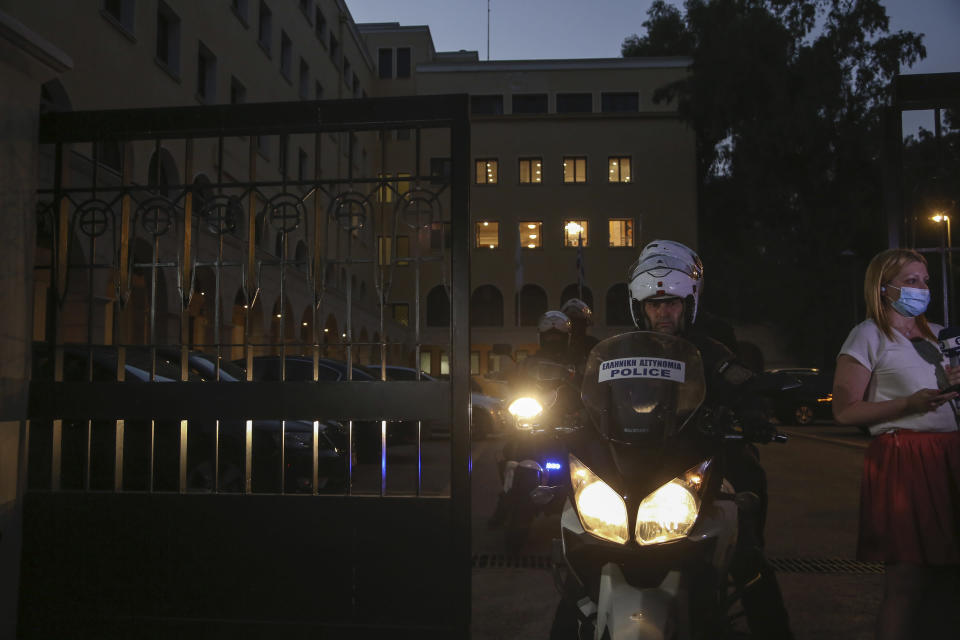 A police officer on a motorcycle exits the Petraki Monastery in Athens, following an attack with a caustic liquid on Wednesday, June 23, 2021. Greek authorities say seven Greek Orthodox bishops have been hospitalized after allegedly being attacked with a caustic liquid by a priest facing a disciplinary hearing in Athens. The incident occurred at a meeting of senior church officials late Wednesday. (AP Photo/Petros Giannakouris)