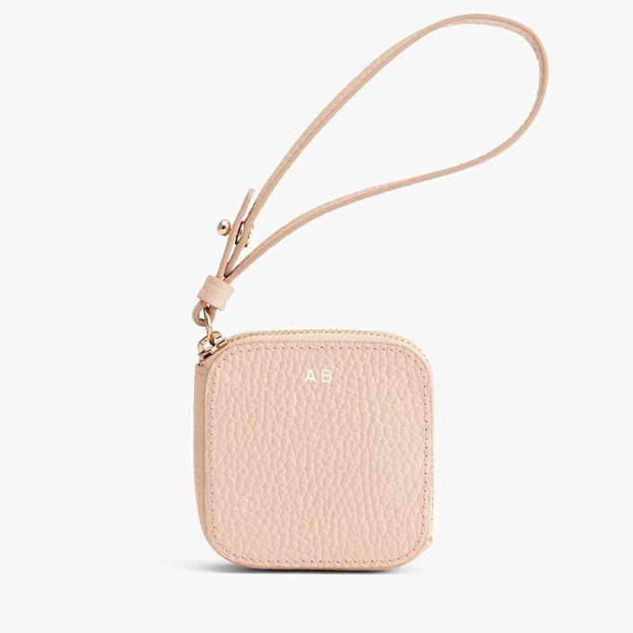 <p>You can get this <span>Cuyana Leather Airpod Case</span> ($50) monogrammed.</p>