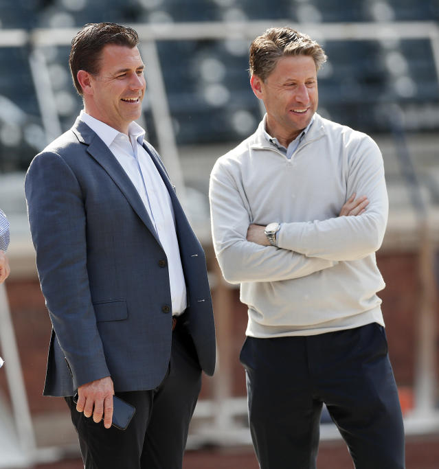NEW YORK, NY - MAY 20: General Manager Brodie Van Wagenen (left) has now traded away 12 prospects since being hired in October. (Getty Images)
