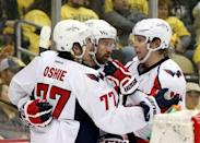 Washington Capitals right wing Justin Williams (middle) celebrates his goall with right wing T.J. Oshie (77) and center Nicklas Backstrom (R) against the Pittsburgh Penguins during the third period in game three of the second round of the 2016 Stanley Cup Playoffs at the CONSOL Energy Center. The Pens won 3-2. Mandatory Credit: Charles LeClaire-USA TODAY Sports