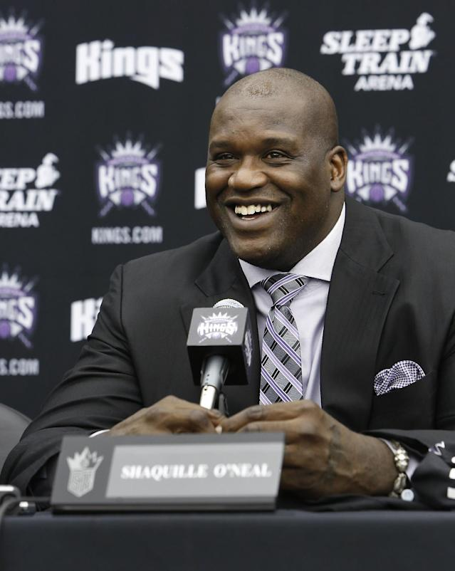 FILE - In this Sept. 24, 2013 file photo, Shaquille O'Neal smiles during a news conference where he was welcomed as one of the new minority owners of the Sacramento Kings in Sacramento, Calif. O'Neal, Grant Hill and Darrell Griffith headline the 2014 College Basketball Hall of Fame class. (AP Photo/Rich Pedroncelli, file)