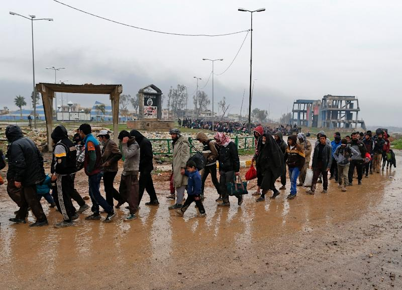 Families fleeing the fighting in Mosul, northern Iraq pictured on March 23, 2017