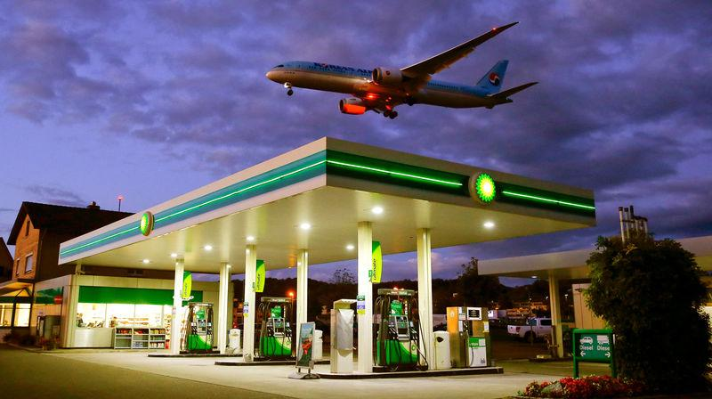 FILE PHOTO - An aircraft of Korean Airlines is seen above a BP petrol station approaching to land at Zurich Airport in Kloten