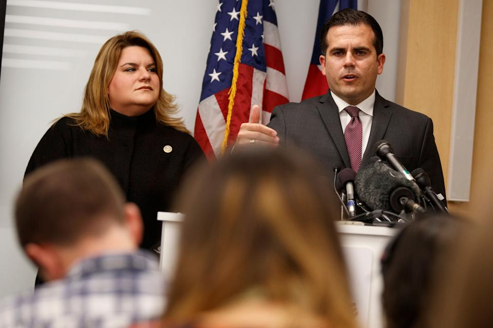 Resident Commissioner Jenniffer Gonzalez-Colon, who represents Puerto Rico as a nonvoting member of Congress, listens as Puerto Rico Gov. Ricardo Rossello speaks during a news conference. (AP Photo/Evan Vucci)