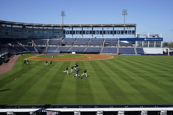 New York Yankees outfielders warm up during a spring training baseball workout Tuesday, Feb. 23, 2021, at George M. Steinbrenner Field in Tampa, Fla. (AP Photo/Frank Franklin II)