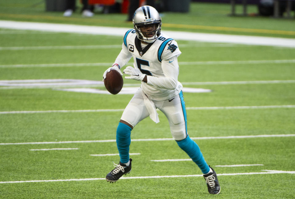 MINNEAPOLIS, MN - NOVEMBER 29: Teddy Bridgewater #5 of the Carolina Panthers runs with the ball in the third quarter of the game against the Minnesota Vikings at U.S. Bank Stadium on November 29, 2020 in Minneapolis, Minnesota. (Photo by Stephen Maturen/Getty Images)