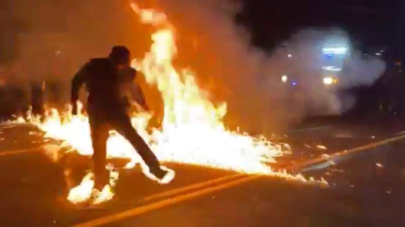 A man is set on fire by a molotov cocktail during the Portland protests.