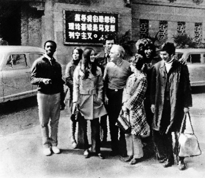 FILE - In this handout, members of the United States table tennis team stand in front of their hotel in Peking, in Communist China, in this Tuesday, April 14, 1971, file photo. From left are: George Braithwaite of Brooklyn, N.Y.; Judy Bochenski of Eugene, Ore.; Olga Soltesz of Orlando, Fla.; Jack Howard of Seattle, Wash.; Graham Stenhoven, president of the United States Table Tennis Association from Detroit; Connie Sweeris of Grand Rapids, Mich.; Glen Cowan of Santa Monica, Calif., and Errol Resek of New York City. Tossed into the middle of a potential thawing in U.S. relations with China, though, Judy Bochenski and her American ping pong teammates helped deliver one of the great diplomatic coups of their time.(AP Photo/File)