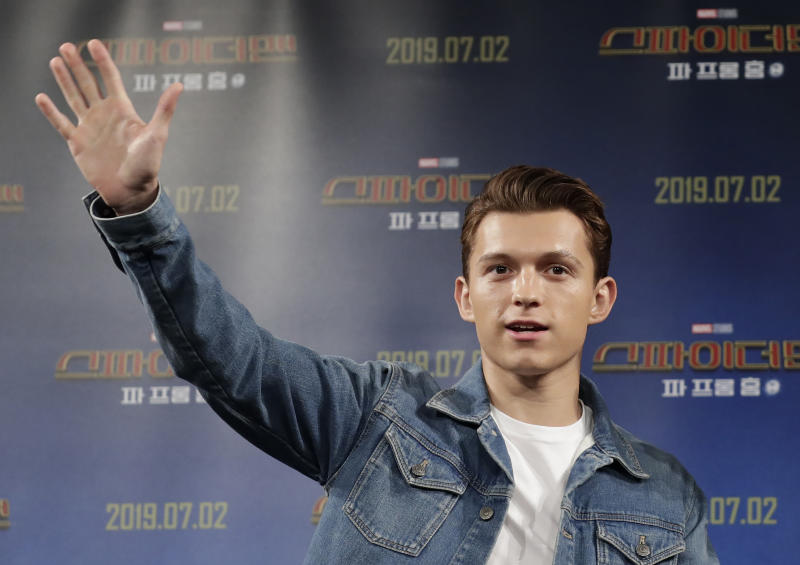"Actor Tom Holland waves upon his arrival at a press conference for his new movie ""Spider-Man: Far From Home"" in Seoul, South Korea, Monday, July 1, 2019. The movie is to be released in South Korea on July 2, 2019. (AP Photo/Lee Jin-man)"