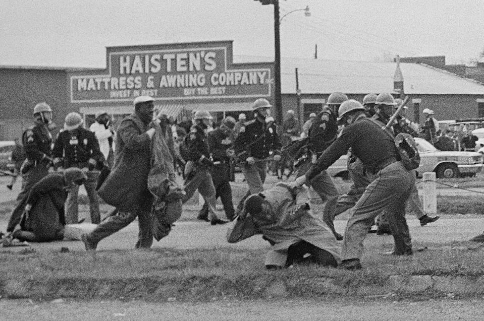State troopers swing billy clubs to break up a civil rights voting march in Selma, Ala., March 7, 1965. John Lewis, chairman of the Student Nonviolent Coordinating Committee (in the foreground) is being beaten by a state trooper. Lewis, a future U.S. Congressman sustained a fractured skull. (Photo: AP)
