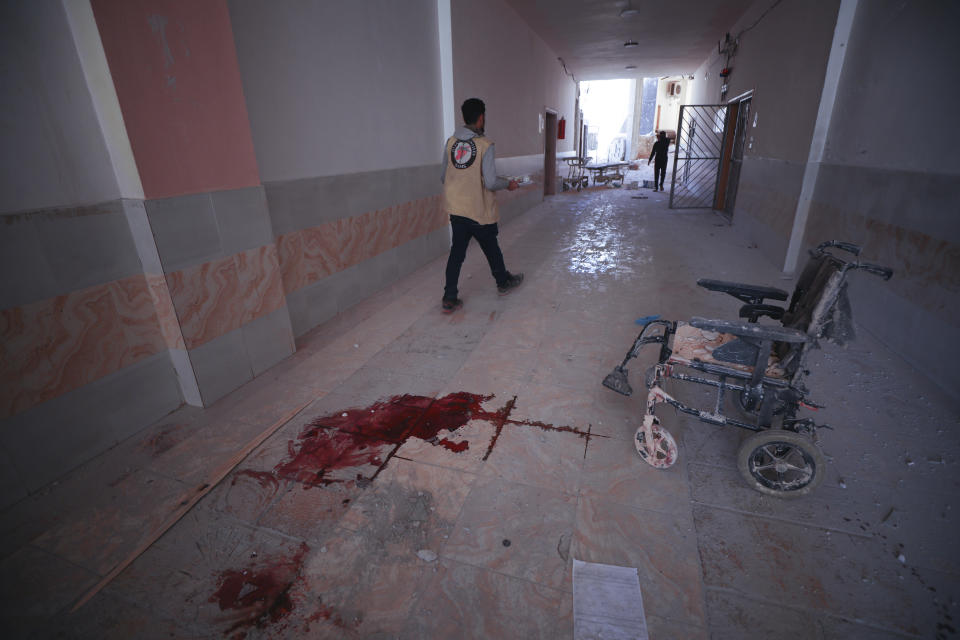 FILE - In this March 22, 2021, file photo, blood splatters the floor of a hospital in Atareb, a town in rural western Aleppo, Syria. Artillery shells fired from government areas killed at least five civilians and wounded medical staff when they landed in front of the hospital. Countries like Lebanon, Syria, Iraq, Lebanon and Yemen are all teetering on the brink of humanitarian catastrophe with an economic implosion that threatens to throw the region into even deeper turmoil. (AP Photo/Ghaith Alsayed, File)