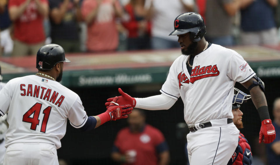 Cleveland Indians' Franmil Reyes, right, is congratulated by Carlos Santana after hitting a two-run home run in the first inning of a baseball game against the Boston Red Sox, Monday, Aug. 12, 2019, in Cleveland. Santana also scored on the play. (AP Photo/Tony Dejak)
