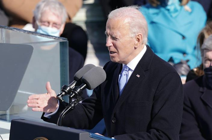 "<span class=""caption"">Joe Biden delivering his inaugural address on the West Front of the U.S. Capitol on January 20, 2021.</span> <span class=""attribution""><a class=""link rapid-noclick-resp"" href=""https://www.gettyimages.com/detail/news-photo/president-joe-biden-delivers-his-inaugural-address-on-the-news-photo/1297453223?adppopup=true"" rel=""nofollow noopener"" target=""_blank"" data-ylk=""slk:Alex Wong/Getty Images"">Alex Wong/Getty Images</a></span>"