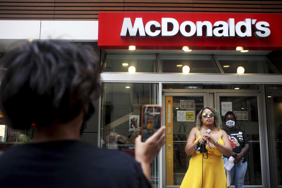 """Amika Tendaji of Black Lives Matter Chicago speaks to people outside the McDonald's restaurant on 180 W. Adams St. in Chicago on Monday, July 20, 2020. The event is a part of a nationwide strike that organizers hoped would involve tens of thousands of people walking off the job. Dubbed the """"Strike for Black Lives,"""" the protest was arranged by labor unions and social and racial justice organizations, which planned a range of actions in more than two dozen U.S. cities. (AP Photo/Joshua Housing)"""