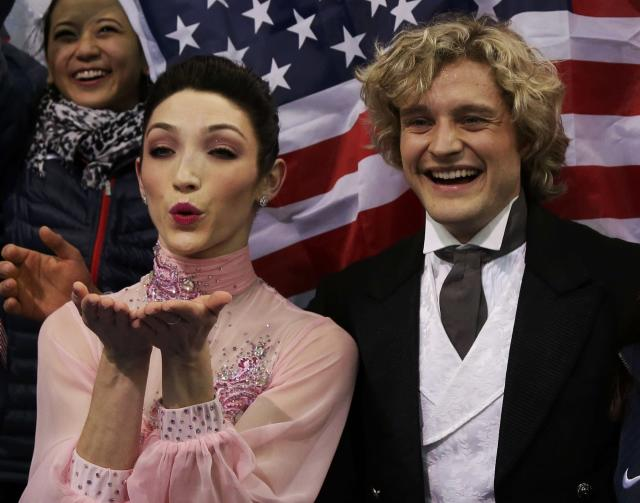 """Charlie White and Meryl Davis of the United States react in the """"kiss and cry"""" area during the Team Ice Dance Short Dance at the Sochi 2014 Winter Olympics, February 8, 2014. REUTERS/Darron Cummings/Pool (RUSSIA - Tags: SPORT FIGURE SKATING SPORT OLYMPICS)"""