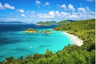 <p>Even though Trunk Bay is St. John's most visited beach, this quarter mile stretch of pristine white sand on the island's north shore is worth braving the occasional crowd.</p>