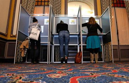 FILE PHOTO: People vote during the Dutch general election, at a polling station opened at Hotel des Indes, in The Hague, Netherlands, March 15, 2017. REUTERS/Yves Herman/File Photo
