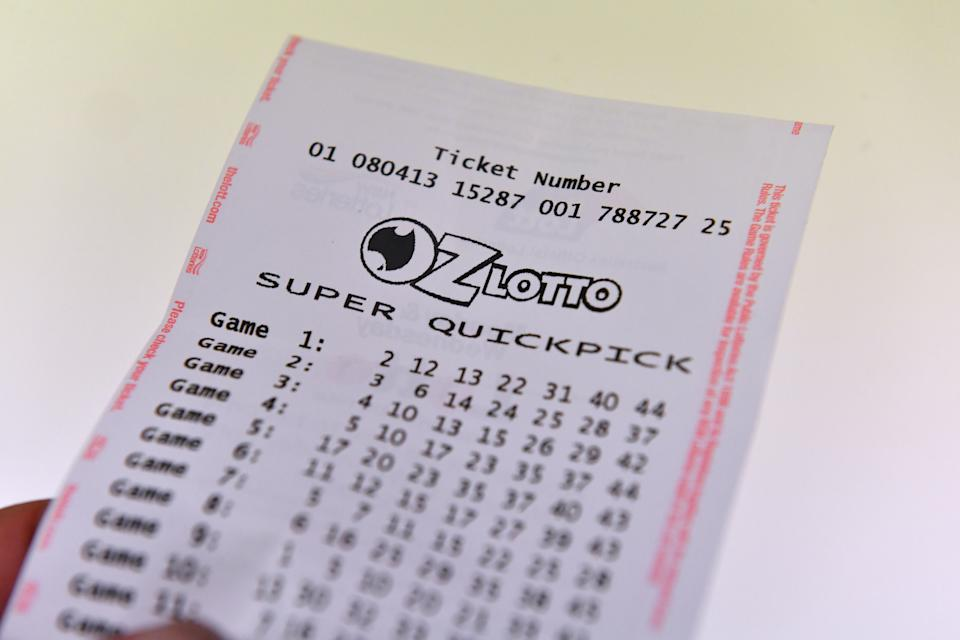 Photo of lotto ticket as players get their entries in for Tuesday's $80million Oz Lotto jackpot.