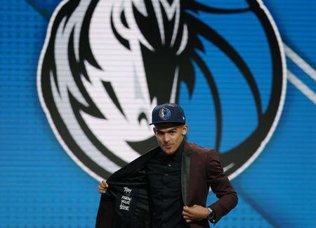 Jun 21, 2018; Brooklyn, NY, USA; Trae Young (Oklahoma) walks to the stage after being selected as the number five overall pick to the Dallas Mavericks in the first round of the 2018 NBA Draft at the Barclays Center. Brad Penner-USA TODAY Sports