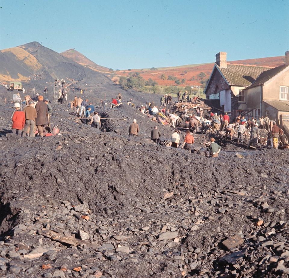 Rescue workers toil in the huge pile of rubble, after the collapse of a slag tip at Aberfan, Wales, Oct. 22, 1966. Many of the local children were killed when the rubble engulfed the village schoolhouse. (AP Photo)