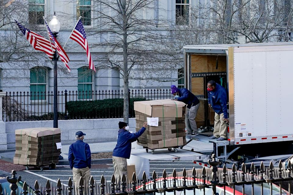 Workers unload pallets of unfolded boxes at the Executive Office Building on the White House grounds Wednesday. (Photo: Erin Scott/Reuters)