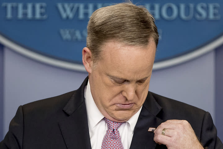White House press secretary Sean Spicer adjusts his American flag pin after he was told that it was upside down March 10, 2017, during the daily press briefing at the White House. (Photo: Andrew Harnik/AP)