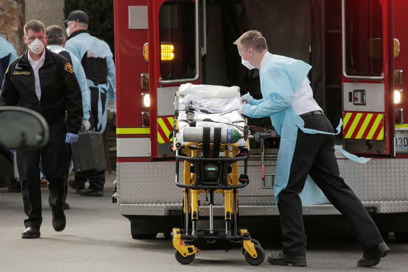 A medic prepares a stretcher to transfer a patient into an ambulance at the Life Care Center of Kirkland, the long-term care facility linked to several confirmed coronavirus cases in the state, in Kirkland