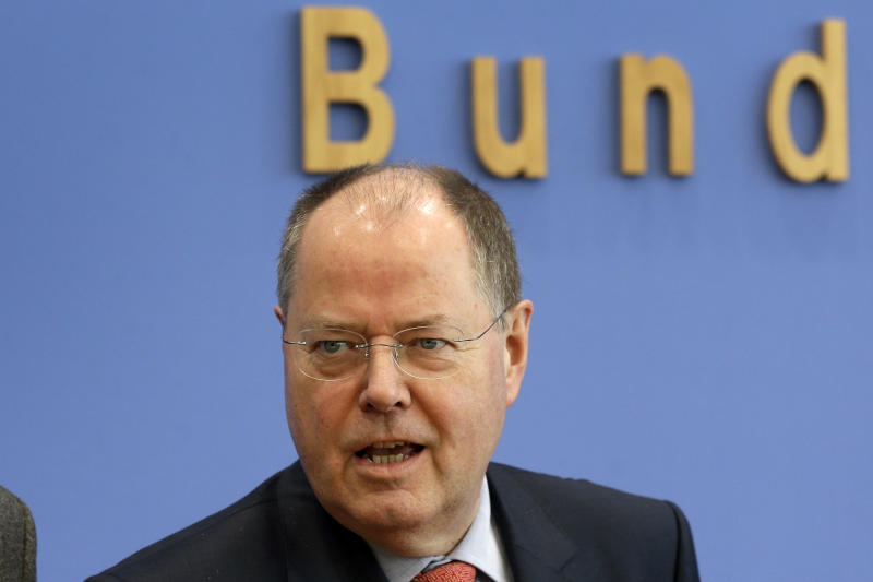 The top candidate of the German Social Democratic Party for the federal elections in  2013, Peer Steinbrueck, poses for the media prior to a joint press conference with the top candidate of the Green Party, Juergen Trittin, unseen in Berlin, Germany, Wednesday, Dec. 12, 2012. (AP Photo/Michael Sohn)