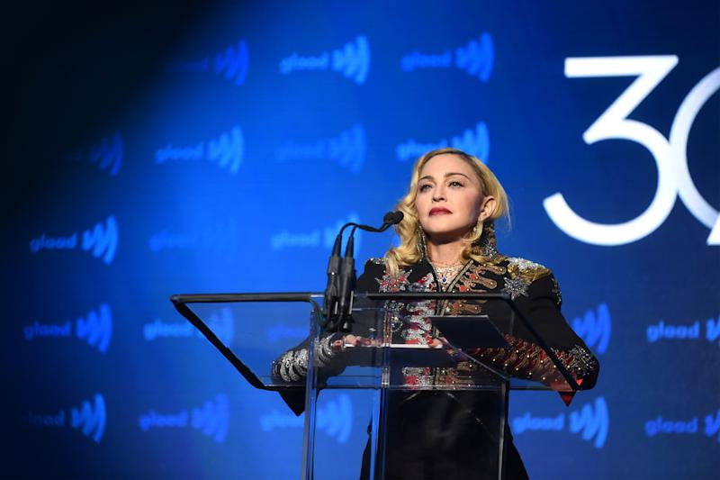 While giving a speech, beautiful Madonna captivated everyone in a black overall with gold and silver designs