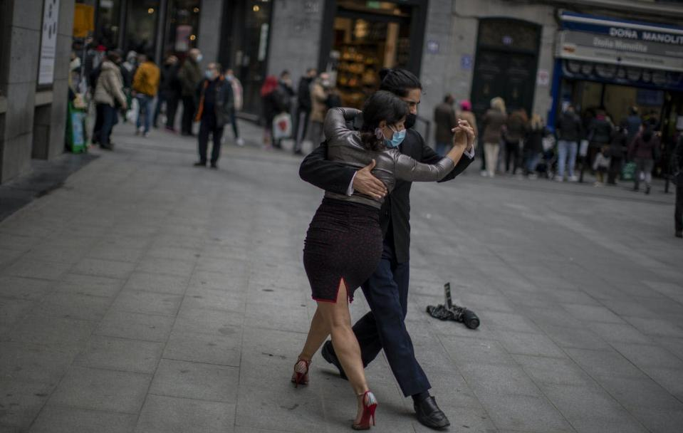 "<span class=""caption"">Street dancers wearing face masks dance the tango in Madrid, Spain, Dec. 16, 2020. </span> <span class=""attribution""><span class=""source"">(AP Photo/Manu Fernandez)</span></span>"