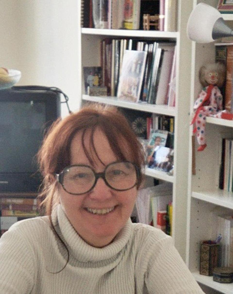 """This circa 2008 photo provided by Donna-Lane Nelson, a Swiss citizen who was formerly U.S. national, shows her in the Paris apartment of a friend who is a French-Syrian writer and psychiatrist. At the U.S. consulate in Geneva, """"I talked to a man who explained to me that I could never, ever get my nationality back,"""" says Nelson, whose Boston accent lingers though she's lived in Switzerland 24 years. """"It felt like a divorce. It felt like a death. I took the second oath and I left the consulate and I threw up."""" (AP Photo/Donna-Lane Nelson)"""