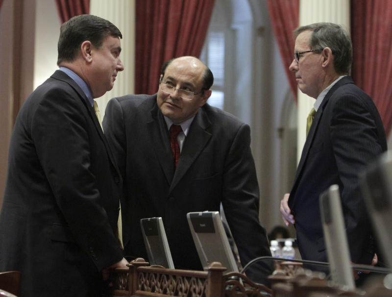 State Senator Joel Anderson, R-La Mesa, left, talks with Senators  Lou Correa, D-Anaheim, center,  and Tom Berryhill, R-Modesto, during the debate over the state budget at the Capitol in Sacramento,  Calif., Wednesday, June 15, 2011  By a 23-15 party-line vote, the measure,  which would see education receiving $3 billion less in state funding in an effort to deal with a $9.6 billion deficit, was approved by the Senate and sent to the Assembly for approval.(AP Photo/Rich Pedroncelli)