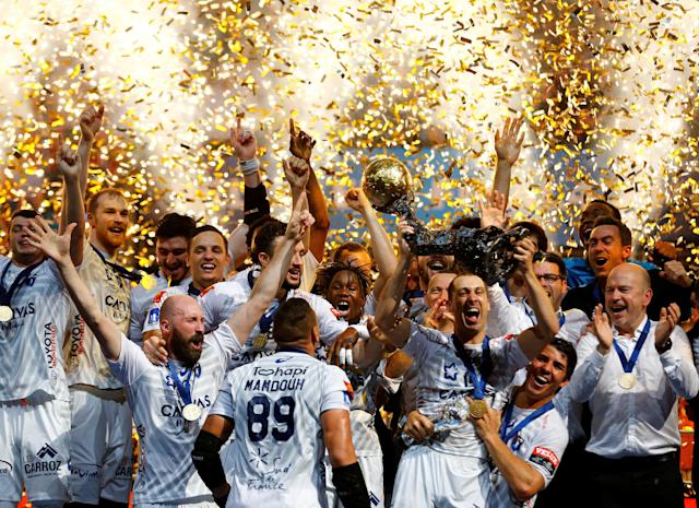 Handball - Men's EHF Champions League Final - HBC Nantes vs Montpellier HB - Lanxess Arena, Cologne, Germany - May 27, 2018. Montpellier HB players celebrate with the trophy. REUTERS/Thilo Schmuelgen TPX IMAGES OF THE DAY
