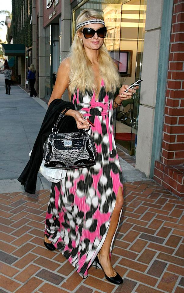 Just another day in Paris Hilton's paradise! The socialite donned a colorful frock and bedazzled headband as she stopped into a few stores in Beverly Hills. (10/26/2011)