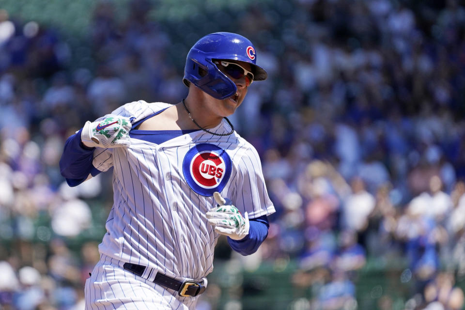 Chicago Cubs' Joc Pederson celebrates his home run off St. Louis Cardinals starting pitcher Johan Oviedo as he runs toward his teammates in the dugout during the fourth inning of a baseball game Friday, June 11, 2021, in Chicago. (AP Photo/Charles Rex Arbogast)