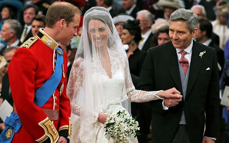 Prince William and Kate Middleton with her father Michael Middleton at Westminster Abbey - Credit: PA