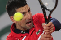 Serbia's Novak Djokovic plays a shot against Russia's Karen Khachanov in the fourth round match of the French Open tennis tournament at the Roland Garros stadium in Paris, France, Monday, Oct. 5, 2020. (AP Photo/Michel Euler)