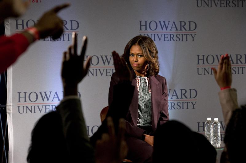 First lady Michelle Obama watches as hands shoot up during a town hall meeting at Howard University in Washington, Thursday April 17, 2014 . The first lady joined juniors and seniors from Chicago public high schools on the first day of their four-day visit to Howard University, as part of a program to immerse talented high school students in a college campus environment. (AP Photo/Jacquelyn Martin)