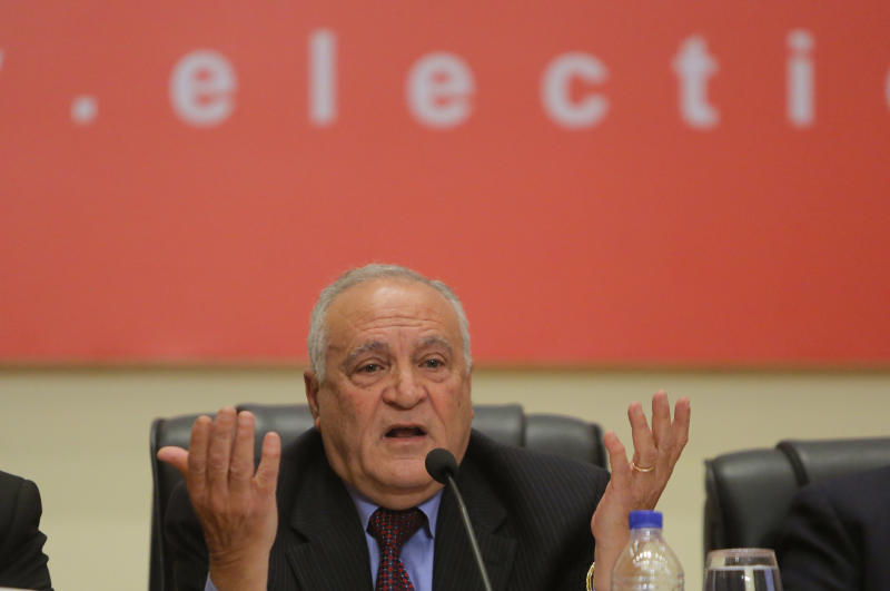 """Judge Nabil Salib, head of Egypt's High Election Commission, announces the voting results of a referendum on Egypt's military-backed constitution, saying 98.1 percent supported it in the first vote since a coup toppled the country's president, in Cairo, Egypt, Saturday, Jan. 18, 2014. In the lead up to the vote, police arrested those campaigning for a """"no"""" vote on the referendum, leaving little room for arguing against the document. (AP Photo/Amr Nabil)"""