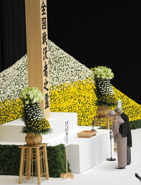 Japan's Emperor Akihito and Empress Michiko offer silent prayers for the war dead in front of the main altar decorated with huge bank of chrysanthemums during a memorial service at Budokan Martial Arts Hall in Tokyo, Thursday, Aug. 15, 2013, marking the 68th anniversary of its World War II surrender.(AP Photo/Itsuo Inouye)