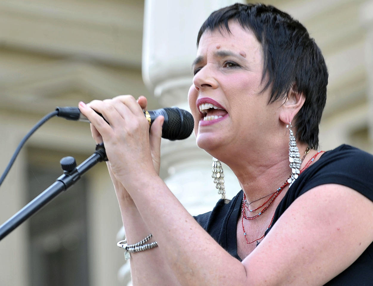 """Eve Ensle, author of """"The Vagina Monologues,"""" speaks during a performance of her play by Democratic state Rep. Lisa Brown, 10 other lawmakers and several actresses on the Michigan Statehouse steps, Monday, June 18, 2012, in Lansing, Mich. Brown, who says she was barred from speaking in the Michigan House because Republicans objected to her saying """"vagina"""" during debate over anti-abortion legislation, performed with help from author Ensler. (AP Photo/Detroit News, Dale G. Young)"""