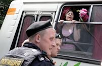 "Detained gay rights activists shout from a police bus near the State Duma, Russia's lower parliament chamber, in Moscow, Russia, Tuesday, June 11, 2013. Protesters attempted to rally outside the Russian State Duma before what is expected to be a final vote on the bill banning ""propaganda of nontraditional sexual relations."" More than two dozen activists were detained in Moscow on Tuesday as they were protesting a bill that stigmatizes the gay community and bans the giving of information about homosexuality to children. (AP Photo/Ivan Sekretarev)"