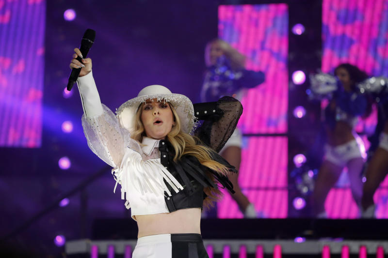 Singer Ellie Goulding performs at half time of an NFL football game between the Buffalo Bills and Dallas Cowboys in Arlington, Texas, Thursday, Nov. 28, 2019. (AP Photo/Michael Ainsworth)