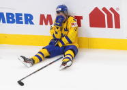 Sweden's Noel Gunler (28) reacts after the loss to Finland after an IIHL World Junior Hockey Championship game, Saturday, Jan. 2, 2021 in Edmonton, Alberta. (Jason Franson/The Canadian Press via AP)