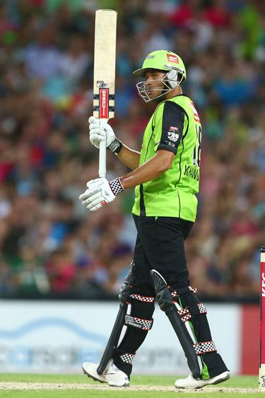 Usman Khawaja of the Thunder celebrates his half century during the Big Bash League match between Sydney Thunder and the Sydney Sixers at ANZ Stadium on December 30, 2012 in Sydney, Australia.  (Photo by Mark Kolbe/Getty Images)