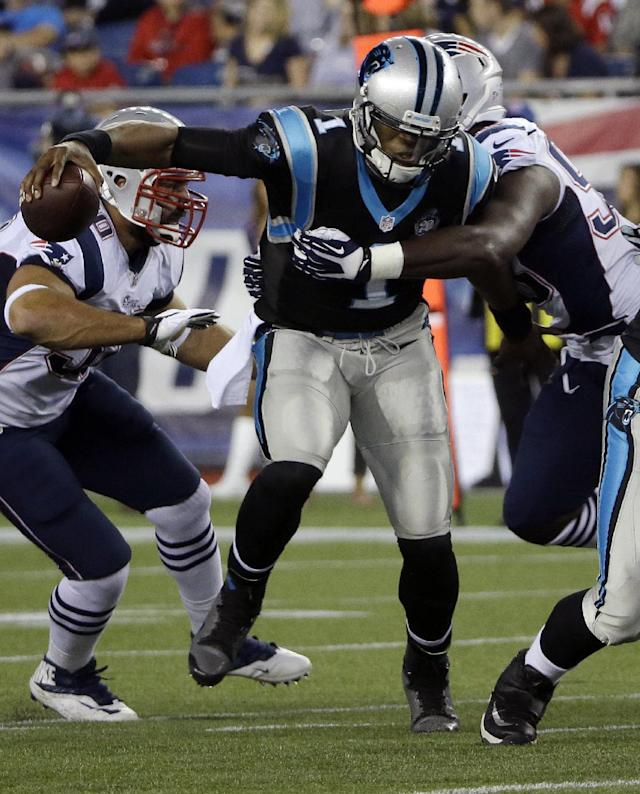 New England Patriots defensive end Chandler Jones, right, sacks Carolina Panthers quarterback Cam Newton (1) in the first half of an NFL preseason football game Friday, Aug. 22, 2014, in Foxborough, Mass. (AP Photo/Stephan Savoia)