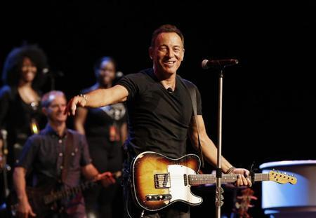 Singer Bruce Springsteen greets journalists during a sound check session ahead of his concert in Cape Town