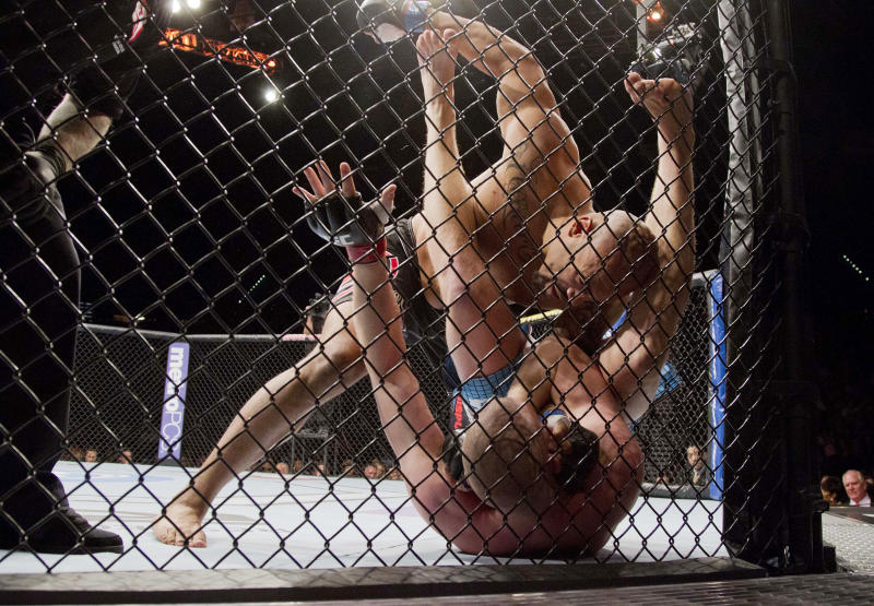 Lavar Johnson, top, throws punches against Stefan Struve in the first round during a UFC 146 heavyweight bout, Saturday, May 26, 2012, in Las Vegas. Struve won by tap out on an arm bar. (AP Photo/Julie Jacobson)