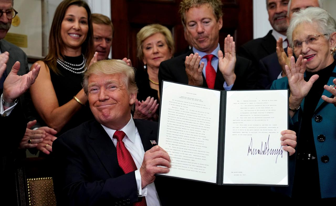 FILE PHOTO: U.S. President Donald Trump smiles after signing an Executive Order to make it easier for Americans to buy bare-bone health insurance plans and circumvent Obamacare rules at the White House in Washington, U.S., October 12, 2017.  REUTERS/Kevin Lamarque/File Photo