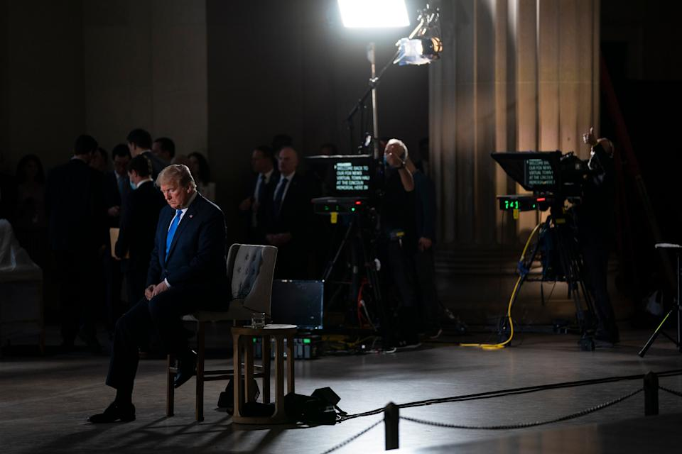 <p>File Image: In this 3 May, 2020, file photo President Donald Trump waits for a segment to start during a Fox News virtual town hall from the Lincoln Memorial in Washington. </p> (AP)